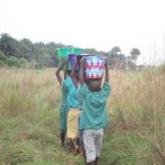 The Water Project: Lokomasama, Bompa, DEC Bompa Primary School -  Students Carrying Water