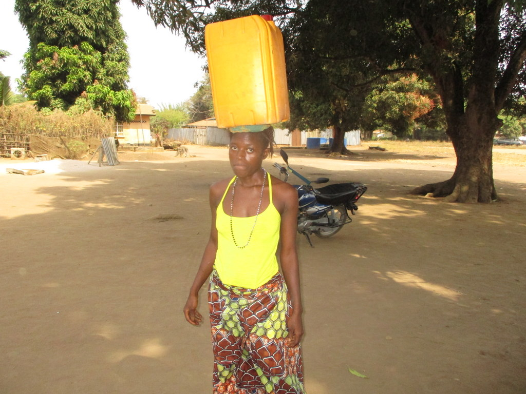 The Water Project : sierraleone19276-carrying-water