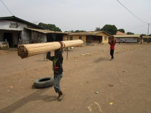 The Water Project:  Laborers Carrying Wood