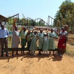 The Water Project: Lwanga Itulubini Primary School -  Students At School Gate