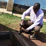 The Water Project: Mabanga Primary School -  Removing The Hatch To Redo The Catchment Area