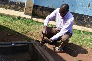 The Water Project:  Removing The Hatch To Redo The Catchment Area