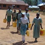 The Water Project: Lwanga Itulubini Primary School -  Students Leaving To Fetch Water