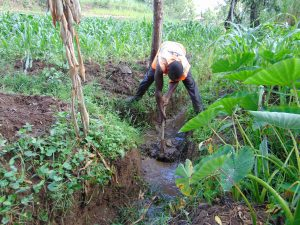 The Water Project:  Digging Drainage For The Spring