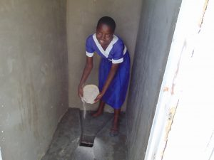 The Water Project:  Treating Latrine Using Ash