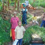 The Water Project: Bukhakunga Community, Mukomari Spring -  Bringing Materials To The Construction Site