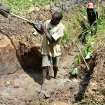 The Water Project: Emukoyani Community, Ombalasi Spring -  Community Members Helping Excavate