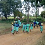 The Water Project: Ingwe Primary School -  Students Bring Water For Mixing Cement