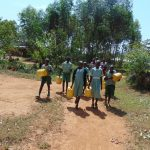 The Water Project: Lwanga Itulubini Primary School -  Going To Fetch Water