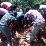 The Water Project: Mukhunya Community, Mwore Spring -  Community Members Trying To Catch A Mud Fish