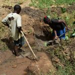 The Water Project: Emukoyani Community, Ombalasi Spring -  Excavating