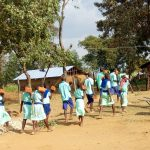 The Water Project: Ingwe Primary School -  Carrying Bricks To The Construction Site