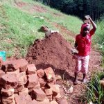 The Water Project: Mukhunya Community, Mwore Spring -  Delivering Bricks To The Construction Site