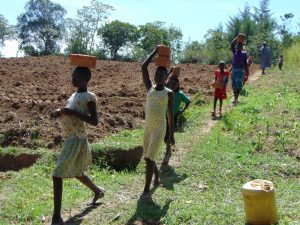 The Water Project:  Community Members Carrying Bricks To The Site