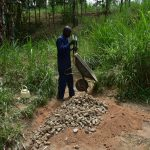 The Water Project: Emukoyani Community, Ombalasi Spring -  Delivering Stones To The Site
