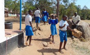 The Water Project:  Students Carrying Stones