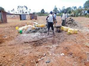 The Water Project:  Using Water That Students Delivered To Mix Cement
