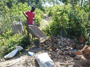 The Water Project:  Bringing Rocks To The Construction Site
