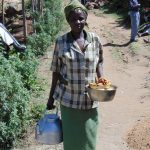 The Water Project: Imbinga Community, Arunga Spring -  Woman Bringing Food To Work Team
