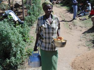 The Water Project:  Woman Bringing Food To Work Team