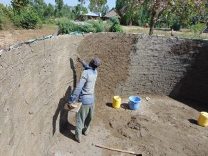 The Water Project:  Plastering The Tank Wall