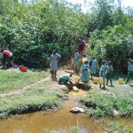 The Water Project: Lwanga Itulubini Primary School -  Fetching Water