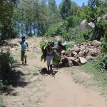 The Water Project: Imbinga Community, Arunga Spring -  Bringing Banana Leaves To Cover Drying Cement