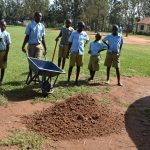 The Water Project: Mabanga Primary School -  Students Helping The Team Remake The Catchment Area