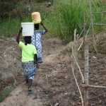 The Water Project: Emukoyani Community, Ombalasi Spring -  Carrying Water From The Protected Spring