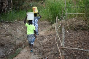 The Water Project:  Carrying Water From The Protected Spring