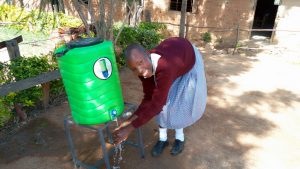 The Water Project:  Agatha Washing Her Hands