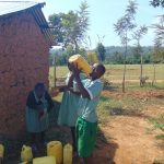 The Water Project: Lwanga Itulubini Primary School -  Student Drinking Water