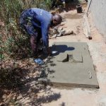 The Water Project: Kambiri Community, Sachita Spring -  Sanitation Platform Construction