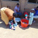 The Water Project: Lwanga Itulubini Primary School -  Serving Porridge