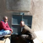 The Water Project: Kapkemich Primary School -  Mbone And Mr Kiprotich Are Delighted With The Water Tank