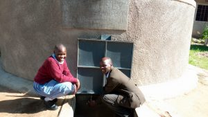 The Water Project:  Mbone And Mr Kiprotich Are Delighted With The Water Tank