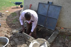 The Water Project:  Humphrey Plastering The Inside Of The New Catchment Area