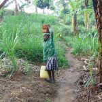 The Water Project: Bukhakunga Community, Mukomari Spring -  Carrying Bricks To The Artisan