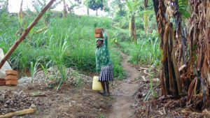 The Water Project:  Carrying Bricks To The Artisan