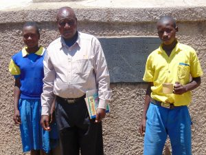 The Water Project:  Marion Cheagat Mr John Mundehe And Clinton Kibisu