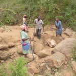 The Water Project: Mbau Community B -  Clearing Ground