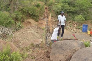 The Water Project:  Digging Out Dam Area