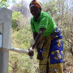 The Water Project: Ndithi Community A -  Fetching Water At New Well