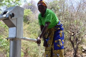 The Water Project:  Fetching Water At New Well