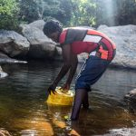 The Water Project: Kasekini Community -  Fetching Water