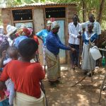 The Water Project: Mbau Community C -  Asking Questions About Tippy Tap