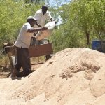 The Water Project: Mbau Community C -  Hauling Bag Of Cement