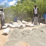 The Water Project: Mbau Community C -  Mixing Sand And Cement