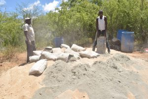 The Water Project:  Mixing Sand And Cement