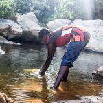 The Water Project: Kasekini Community A -  Fetching Water
